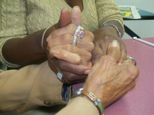 The hands of Dr Margaret Burroughs and Beverly Reed Scott